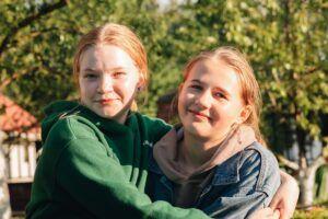 portrait-of-smiling-happy-teenage-school-girls-fri-C38Q59Y